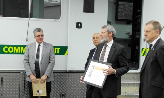 Dr Rod Carr receiving a Certificate of Appreciation from St John 2.JPG